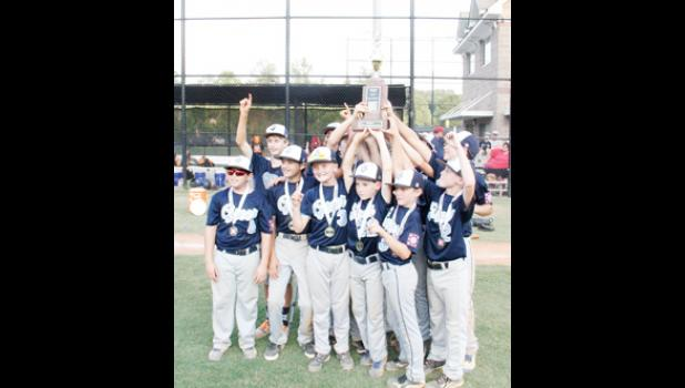 Greer's 12U baseball team hoisted the District trophy last week after a win over Seneca.