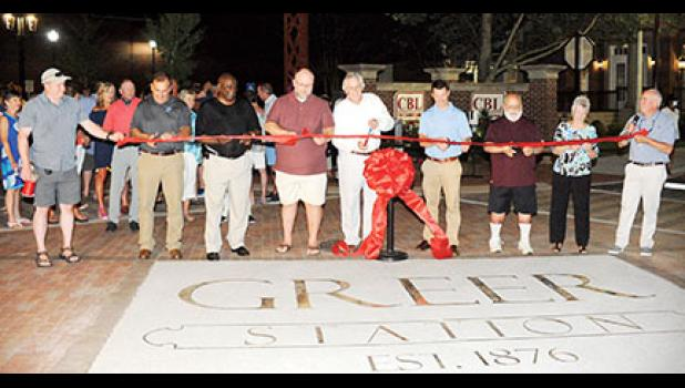 Greer City Council members and Mayor Rick Danner cut the ribbon on the CenterG streetscape project this week.