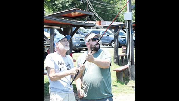 Frank Enos (left) had his first fish slip off the line and swim away.