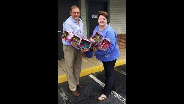 Donny Kauffman, with Greer Community Ministries, and Martha Bennett, with the Greer Soup Kitchen, helped to spread cheer last week with roses from Carlstedt's.