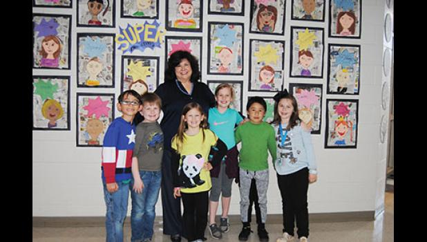 Dr. Carolyn Styles, Principal at Skyland Elementary School, welcomed (from left to right) Gabriel Gallion, Evan Bunnell, Abigail Miller, Kaeleigh Ware, Jesus Ortega and Ashlyn Fulkerson back inside the school building last Thursday afternoon.