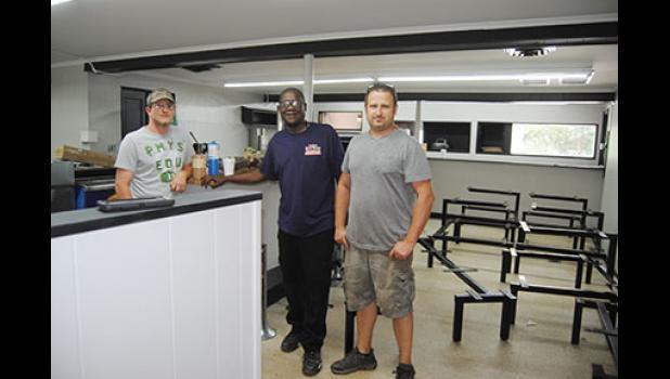 Bobby Jones, Brandon Hammett and Scott Cannon Jr. worked on the restaurant last week.