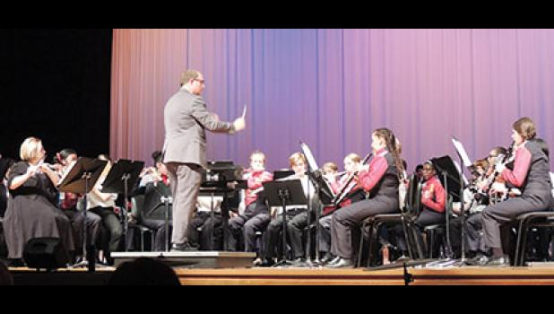 Riverside High band director Kris Bence led the band in the premiere performance of 'Unwavering Heart' last Tuesday.