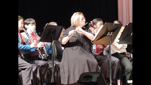 Bella Muntean's private flute teacher, Wendy Smith, played with the band during the commission performance.