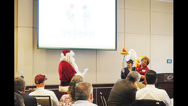 The Greer Cultural Arts Council acted out its presentation with Zazu from Lion King, Santa Claus and a dragon at the Greer Chamber's First Friday Luncheon last week.