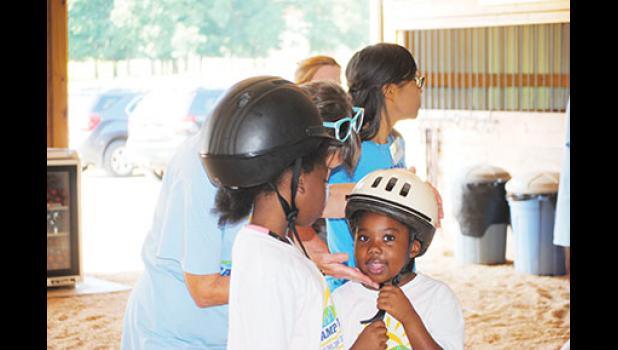 Yamiyah Barksdale, 8, (left) and her younger sister Azariah Barksdale-Jackson, 7, (right) visited the ranch last Tuesday.