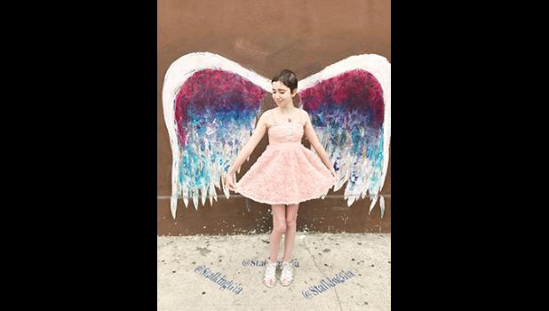 Bella Muntean posed at the Angel Wall on her Make A Wish trip in California.
