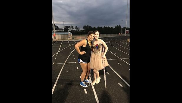 Hailey Phillips, left, and Bella Muntean celebrated 'Gold Out' at the Riverside homecoming game.
