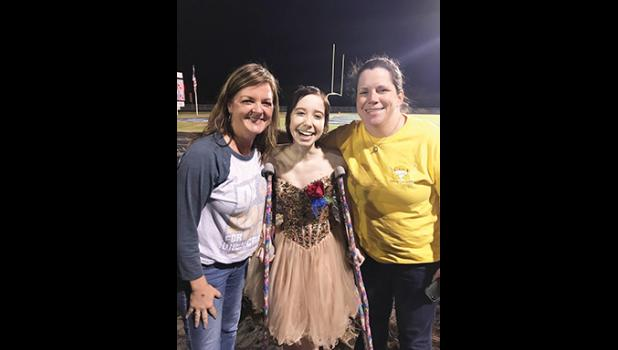 Amy Bowers, Bella's social worker from GHS, Bella Muntean, and Dr. Nicole Bryant, one of Bella's oncologists, celebrate at the Riverside High homecoming game.