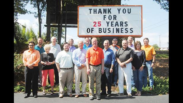 Chuck Langston celebrated 25 years with a luncheon at his business last Friday. Front row, left to right: Mehul Shah, Sally Brock, Brad Toy, Jeff Howell, Chuck Langston, Miles Nason, Jim Griffin, Renee Raffaldt. Back Row, left to right: RW Abel, Paul Lister, Bob Ashworth, Rob Safrit, Doug Nason, Tim Allender, Will Lavender.