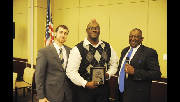 Justin Miller, left, and Greer Councilman Wayne Griffin, right, presented Sammy Dotson with the 2017 Samaritan Award at the annual Martin Luther King Jr. Celebration Luncheon on Monday.