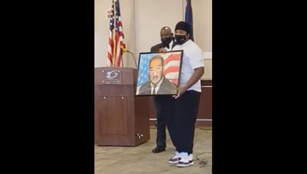 Councilmember Wayne Griffin recognized Joseph Mack, popularly known as Joey Withinarts, for his artwork depicting Martin Luther King Jr.
