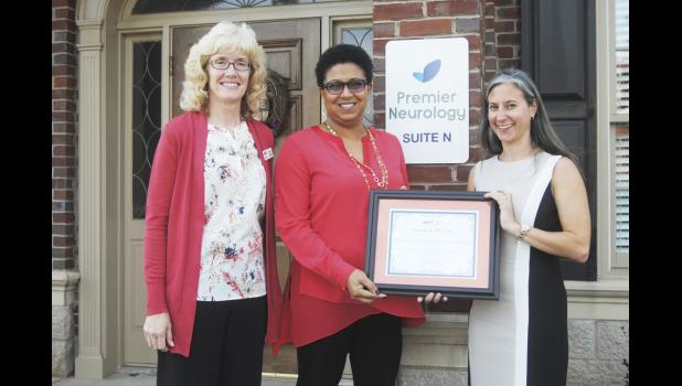 Kaye Gooch (left), Executive Vice President, and Kristina Fransel McGraw (right), Greater Carolinas Chapter President recognized Dr. Mary Hughes of Premier Neurology.