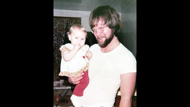 Francis is pictured here with his eldest daughter Erica around the time he earned his master's degree from USC.