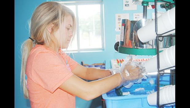 Ally Kunkel, 18, has served many customers in the past week since Pelican's SnoBalls opened for business last Wednesday.