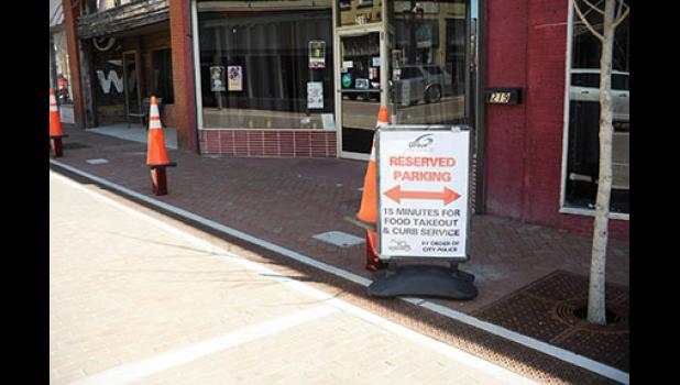 Some Trade Street parking is now dedicated to downtown patrons who are continuing to support local restaurants.