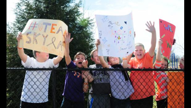 A group of Team Skyla supporters shout  her name at a recent parade.