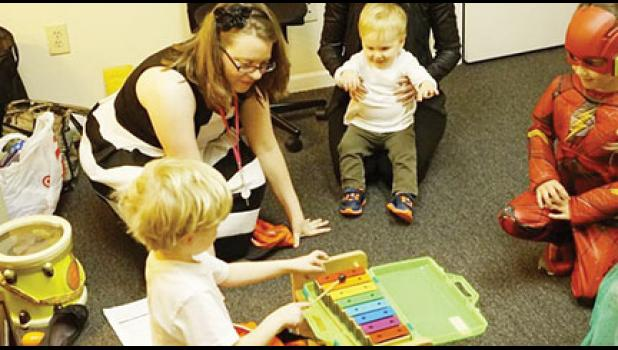 Kendra Zimmerman teaches local students Suzuki piano lessons using a xylophone.