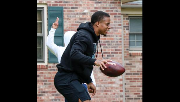 Troy Pride Jr. of the Carolina Panthers will host a football camp at Dooley Field on May 29.