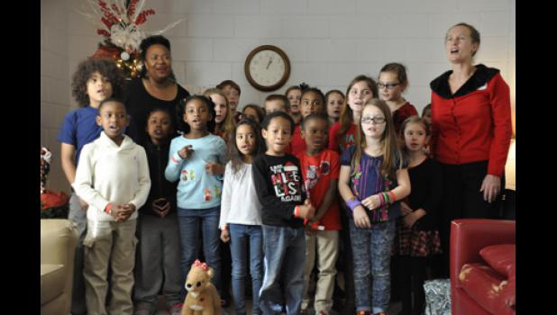 Melissa Hyatt's class, joined by the bus driver, sang 'Jingle Bells' to a group of seniors, followed by 'We Wish You a Merry Christmas.'