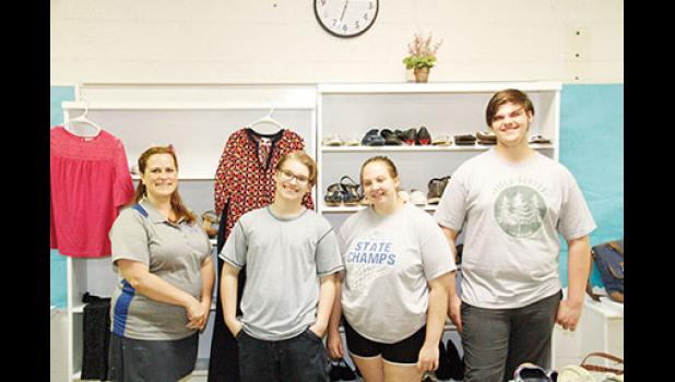 Rhonda Dodson, Skyler Tipton, Gabrielle Butz and Alexander Butz, left to right, have spent the summer creating Byrnes High's Clothing closet.