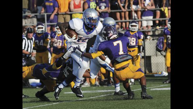 Byrnes wide out Jaylan Foster breaks a tackle during Friday night's season opening win over Northwestern. The Rebels downed the Trojans 30-22 after an onslot of scoring in the first half.