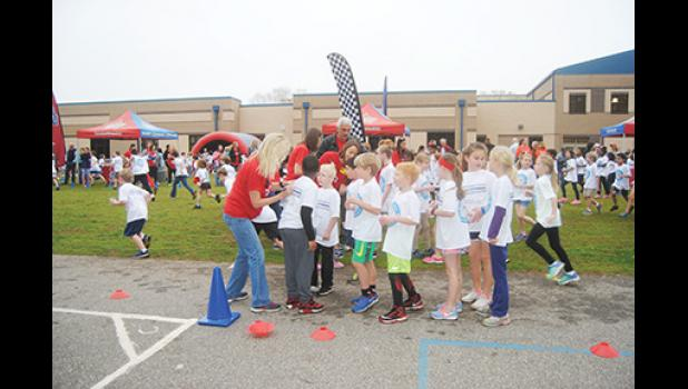 Buena Vista Elementary School teachers marked the number of laps run by each student during Friday's Boosterthon Fun Run at the school.
