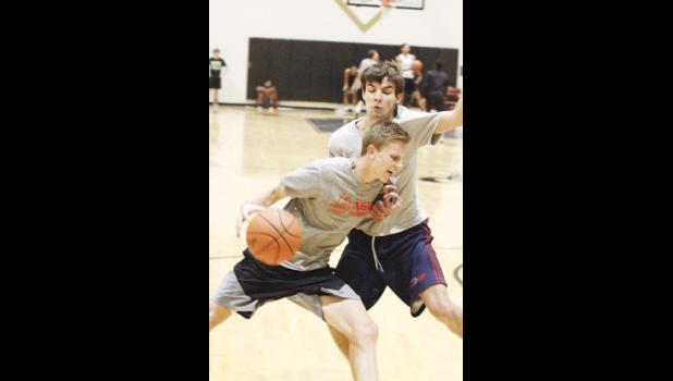 Sam Gravley, pictured left, will help lead the Greer boys basketball team this winter, as the Jackets look to take control of the region.