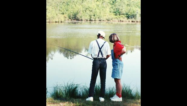 Grant joins a patient fishing during an off-campus fishing trip.