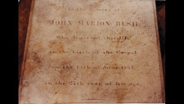 This memorial reads: 'John Marion Rush who departed this life in the faith of the Gospel on the 19th of June, 1853 in the 27th year of his age.'
