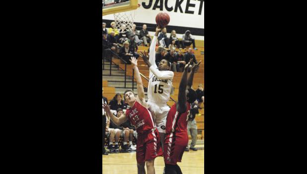 Greer's Malik Archibald puts up a shot over two Tiger defenders during the Yellow Jackets overtime victory over rival Blue Ridge Thursday night.