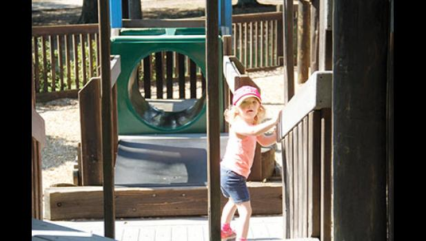 Sections of Kids Planet are closed to the public until the equipment can be repaired.  Ryan Lanier (above) enjoyed the open section of the playground on Monday.