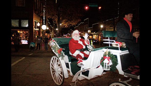 Santa stole the show on Trade Street Friday night, as Greer residents attended the city's annual tree lighting ceremony.