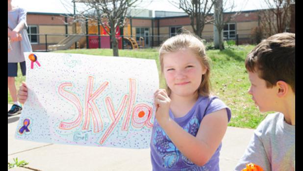 Natalie Rackley holds up her Skyla sign.
