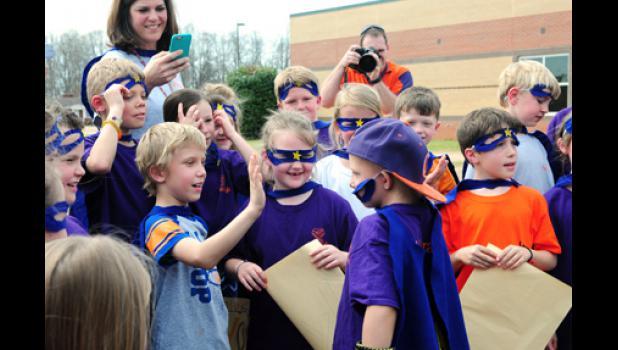 Missy Price's second grade class greets Skyla Forcier.