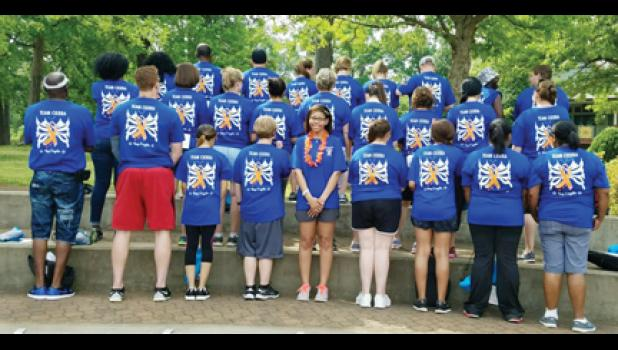Team Cierra shows support for its classmate, Hill, during  an MS walk in Spartanburg Saturday.