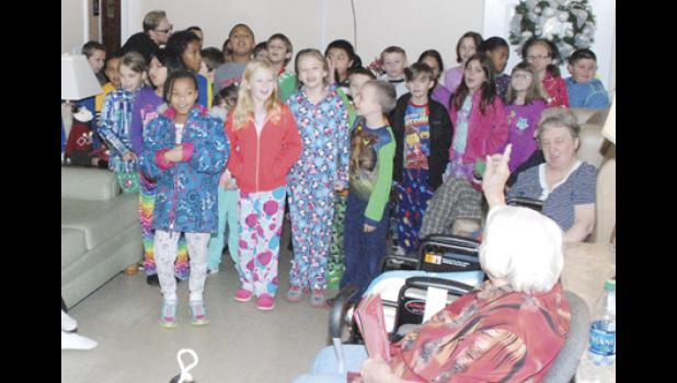 Students from Wellford Academy of Science and Technology sang Christmas carols at Midway Residential Care last Thursday.  There were 18 students in attendance.