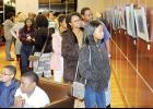 Community members came out to Greer City Hall last Tuesday to view an exhibit of handmade photographs featuring individuals living with Sickle Cell Disease.