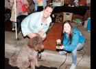 Angela Giles, with her dog Charlie, won the Best in Show award last Tuesday evening in downtown Greer.