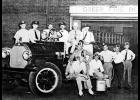 Early Greer Fire Department volunteers are pictured with the station's first fire engine, purchased in 1919. They included, left to right, T.I. Hallman, B.A. Fincher, Joe Brantley, driver, R.B. Colvin, S.O. Mahaffey, the first firemen, W.M. Pennington, W.R. Hunt, Marshal Pennington, Luke Jones, Howell Davis, Dick Singleton, Hoyt Tapp and Bill Allen (standing at the door).