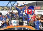 Brad Keselowski, driver of the No. 2 Autotrader Ford, celebrates in victory lane after winning during the Monster Energy NASCAR Cup Series SouthPoint 400 at Las Vegas Motor Speedway in Las Vegas, Nevada.
