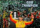 Joey Logano, driver of the No. 22 Shell Pennzoil Ford, celebrates in victory lane after winning the Monster Energy NASCAR Cup Series Ford EcoBoost 400 and the Monster Energy NASCAR Cup Series Championship at Homestead-Miami Speedway in Homestead, Florida.