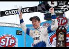 Brad Keselowski, driver of the No. 2 Reese/Draw Tite Ford, celebrates in Victory Lane after winning the Monster Energy NASCAR Cup Series STP 500 at Martinsville Speedway.
