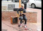 Ronnie Elliott played guitar at the corner of Poinsett and Trade Streets during Greer Station's first Busk at Dusk event Friday. The series continues this Friday with Shamrockin' the Block featuring Irish Step Dancers and Amy Bright - Celtic Harp.