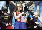 Superman gazes longingly at Wonder Woman's candy haul during the annual Halloween Hoopla event in Greer City Park last Saturday.