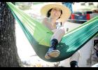 Melanie Milikin relaxes while swinging in a hammock.