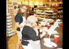 Jessica Brush instructs Susan Dana to 'Paint Ur Pet' at Lowe's Foods in Greer on Thursday.