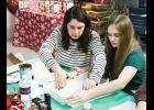 Michelle Gimmi and her daughter Ashlyn, wrap Christmas gifts during POM Self Storage's Christmas Wrapping Workshop on December 2-3 at 207 South Buncombe Road, Greer.