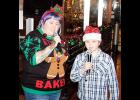 Julie Dunagin and her stepdaughter, Natalie, sang karaoke outside the Mason Jar on Christmas Eve.