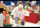 Pamela Davis shopped with her granddaughter Lily Davis during Taylors Elementary's third annual Tinsel Town craft fair and market on Saturday, Nov. 4.